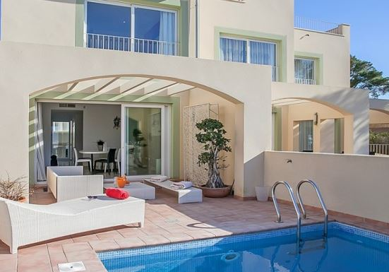 Beautiful designer townhouse for sale Puerto Andratx with sea views to Sa Dragonera