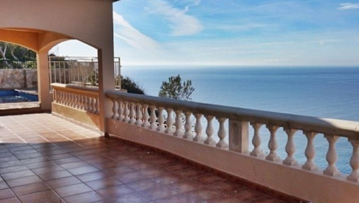 Frontline home for sale in El Toro with stunning sea views